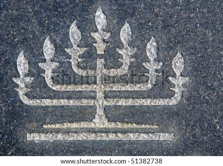 Menorah on granite tombstone. Old Jewish cemetery in California - stock photo