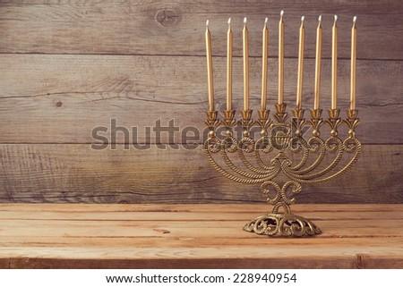 Menorah on wooden table - stock photo