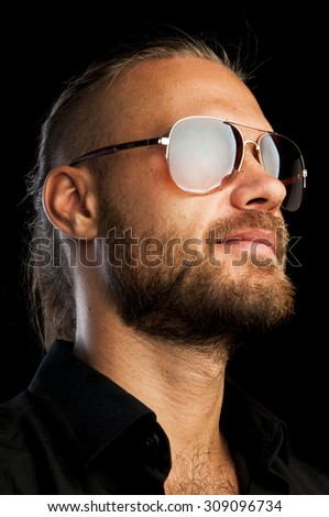 Mens beauty. Portrait of confident young man in sunglasses isolated on black background - stock photo