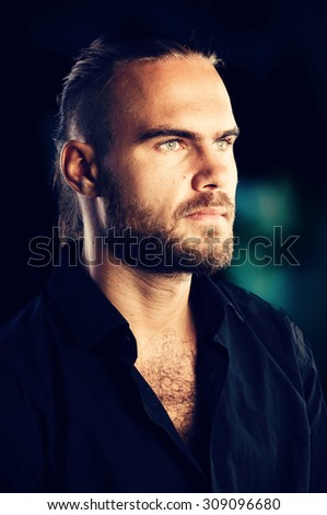 Mens beauty. Portrait of confident young man on dark background - stock photo