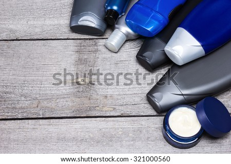 Mens cosmetics background. Various cosmetic products for men on old wooden planks. Copy space - stock photo