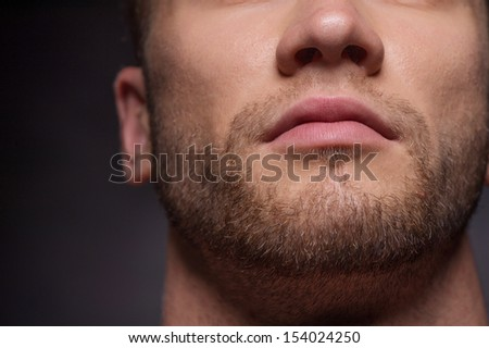 Mens face. Close-up cropped image of mens face isolated on grey - stock photo