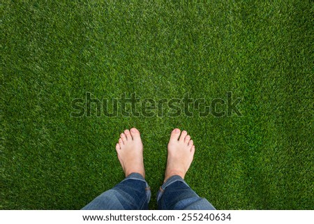 Mens feet standing on grass