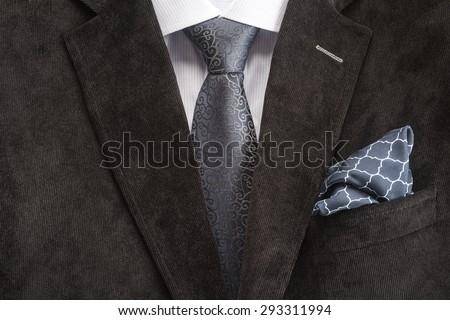 Mens suit, shirt, tie and handkerchief  - stock photo