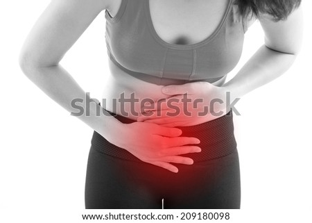 menstruation pain or stomach ache, hand holding belly closeup with red alert accent - stock photo