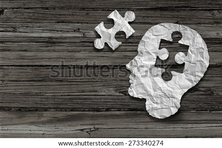 Mental health symbol Puzzle and head brain concept as a human face profile made from crumpled white paper with a jigsaw piece cut out on a rustic old double page spread horizontal wood background. - stock photo