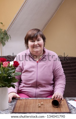 mentally disabled woman throws and has fun - stock photo