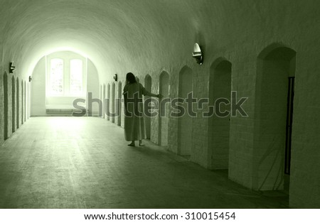 Mentally ill woman walking down the corridor in a mental institution. - stock photo
