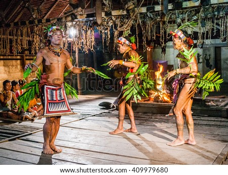 MENTAWAI PEOPLE, WEST SUMATRA, SIBERUT ISLAND, INDONESIA â?? 03 OKTOBER 2011: Men Mentawai tribe dance ritual dance. 03 October, 2011. West Sumatra, Siberut island, Indonesia. - stock photo