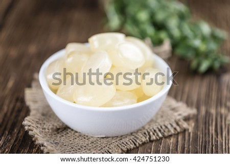 Menthol Candies (close-up shot) on wooden background (selective focus) - stock photo