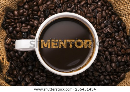 mentor. coffee cup with coffee background - stock photo