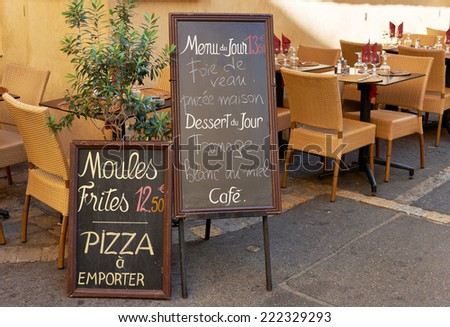 Menu and tables of street restaurant in Aix en Provence town, PACA, France