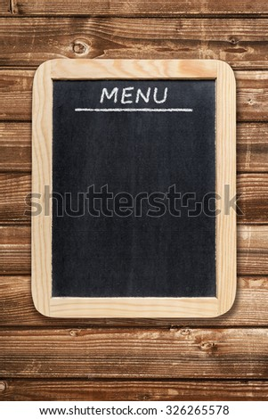 Menu board on wooden background - stock photo