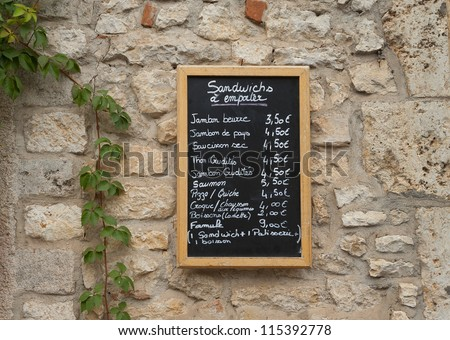 Menu board outside a French restaurant - stock photo