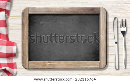 Menu chalkboard top view on table with knife and fork - stock photo
