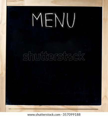 Menu handwritten with white chalk on blackboard in wood frame isolated - stock photo
