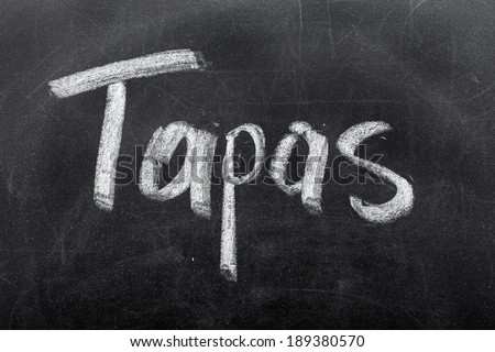 Menu on the blackboard showing what is available. Spanish tapas - stock photo