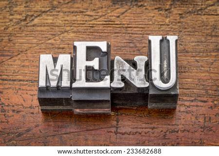 menu word in vintage metal type printing blocks over grunge wood - stock photo