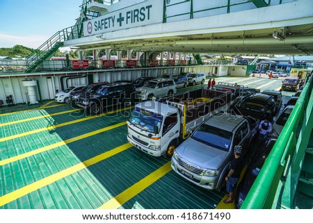 Menumbok,Sabah-May 11,2016:Various vechicles on the Labuan car ferry known as Putra Jaya 1 from Menumbok to Labuan island at Menumbok,Sabah of Borneo on 11th May 2016.