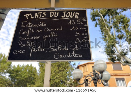 Menusign in France with the plats du jour; that nmenas the meals of the day