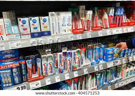 MEPPEN, GERMANY - MARCH 2, 2016: Variety of tooth paste brand in the shelves at the oral care department of a Rewe supermarket. Photo taken on March 2, 2016 in Meppen, Germany