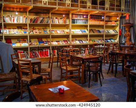 MERCANTIC, SANT CUGAT DEL VALLES, BARCELONA, CATALONIA, SPAIN - MAY 2016: vintage library with wood tables and chairs - stock photo