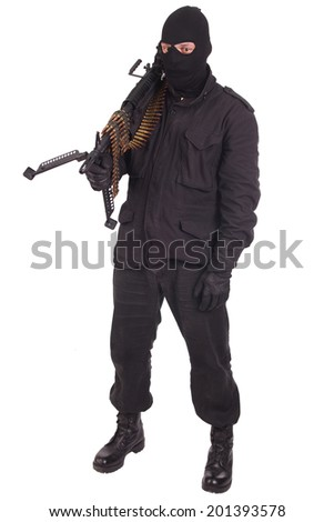 mercenary in black uniforms with machine gun