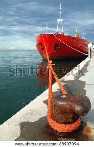 merchant ship docked in the port - stock photo