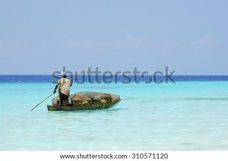 Merchant Transporting Goods - Zanzibar - Tanzania - stock photo