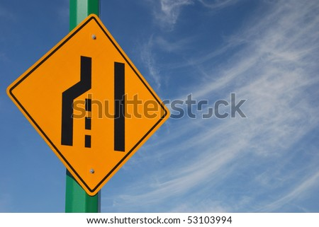 Merge left traffic sign and cloudy sky - stock photo