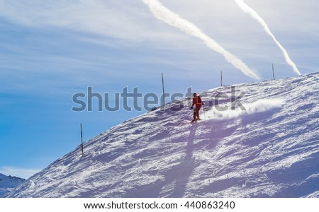 MERIBEL, FRANCE - JANUARY 27, 2016: Skier on the slopes of the ski resort