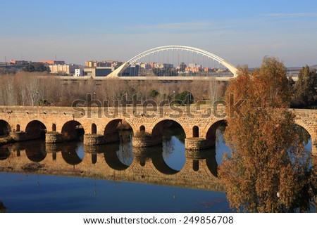 Merida, Badajoz Province, Extremadura, Spain The Roman bridge reflecting on the Guadiana River. UNESCO World Heritage Site. - stock photo