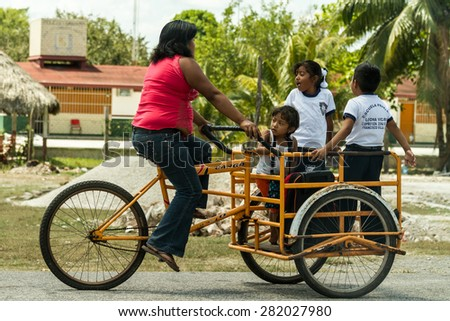 Merida, MEXICO - March 25: Popular transportation by tricycle in Mexico, Merida, MEXICO - stock photo