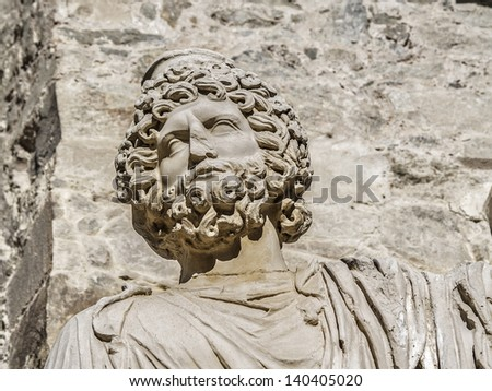 Merida, November 2012. Roman Theater ruins in Merida, capital of Extremadura region in Spain. 16 - 15 B.C.  Nowadays in use for performances. Archeological UNESCO World Heritage Site. Bust sculpture - stock photo