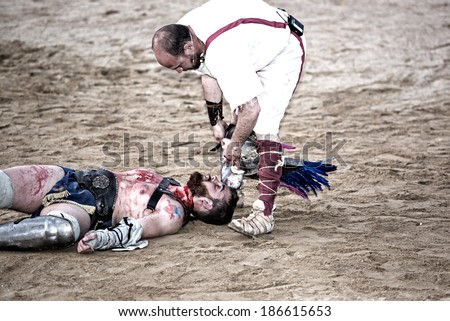 MERIDA, SPAIN,APRIL 5: Patrician people taking part on the performing of gladiators fighting of Merida's Amphitheater on April 05, 2014 in Merida, Spain. The show recreates a gladiator??s fight