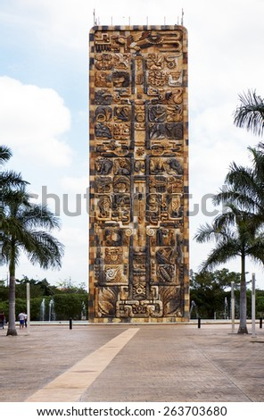 Merida, Yucatan Mexico: January 20, 2015: The 30 meter tall obelisk (stele tower) stands at the entrance to Animaya, a zoo built on the savannah concept just outside of the periferico. - stock photo