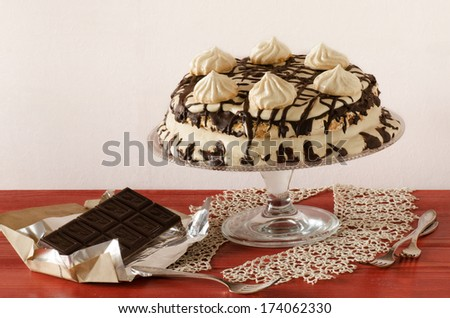 Meringue cake with mascarpone cream and chocolate From series Winter pastry - stock photo
