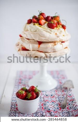 meringue cake with strawberries - stock photo