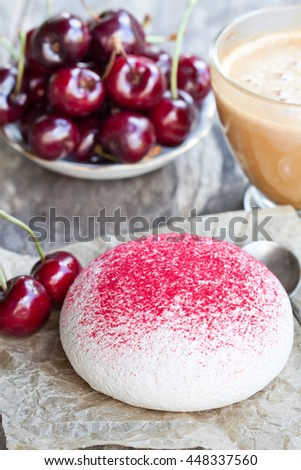 meringue  cookie with fresh berries and cup of coffee  - stock photo