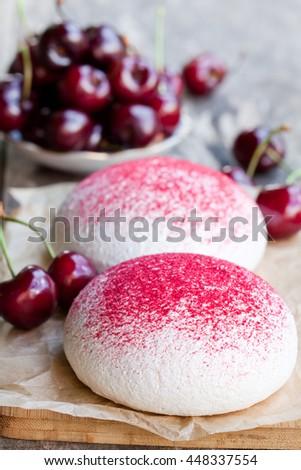 meringue  cookies with fresh berries  - stock photo