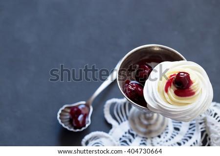 Meringue dessert with cream cheese and cherry jam - stock photo