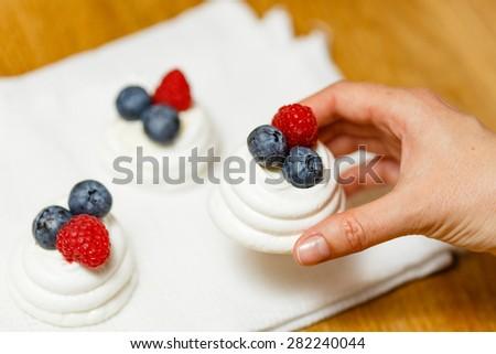 Meringue dessert with fresh berries and whipped cream - stock photo