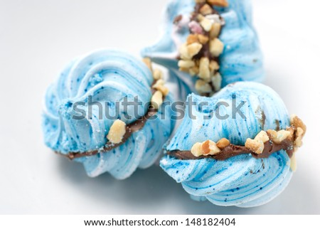 meringue with chocolate and walnut on white plate - stock photo