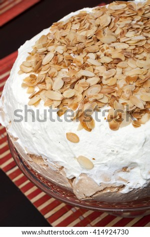 Meringue with whipped cream and pistachios - stock photo