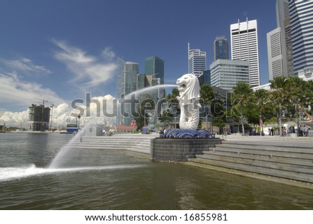 Merlion statue at Merlion Park Singapore.  The Merlion is an icon representing Singapore.  It consist of a lion's head and a fish tail