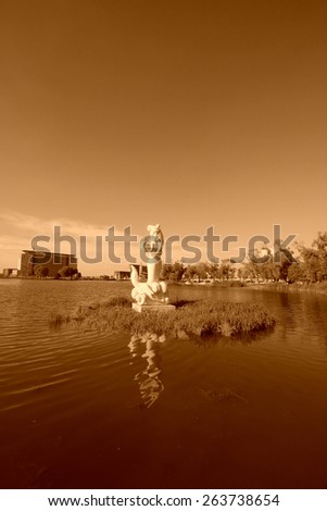 mermaid statue in a park, surrounding environment is very beautiful, in China - stock photo