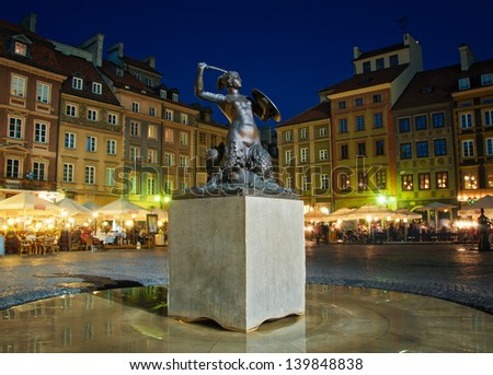 Mermaid statue in the Old Town of Warsaw - stock photo
