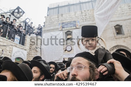 MERON, ISRAEL - MAY 26, 2016: An orthodox child cute and cuddly celebrates Lag Ba'omer in Bar Yochai tomb in Meron,  before Halak ceremony. This is an annual celebration at the tomb of Rabbi Shimon.
