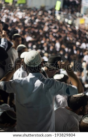 MERON, ISRAEL - MAY 18, 2014: An orthodox Jew raise his hands in dance at the annual hillulah (celebration) of Rabbi Shimon Bar Yochai, in Meron, on Lag BaOmer Holiday.