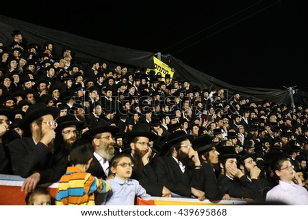 "MERON,ISRAEL- MAY 26, 2016: Orthodox Jews celebrates Lag Ba'omer in Bar Yochai tomb in Meron. Orthodox Jews, singing and dancing annual Hillula the annual ""hilula"" celebration in meron 2016"